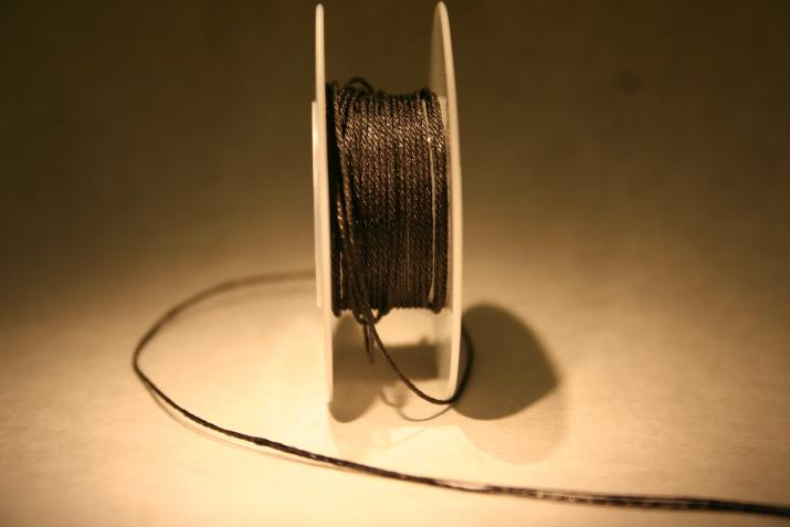 16 gauge wire made of carbon nanotubes shown on a spool