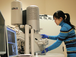picture of a woman using lab equipment