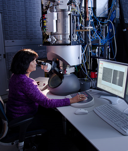 picture of a woman using a scanning probe microscope